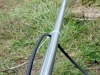 Two top rail posts for a chain link fence welded together.
